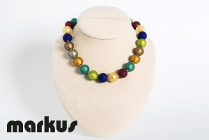 Multicolor frosted glass necklace with yellow gold leaf.